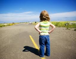 child standing in middle of road